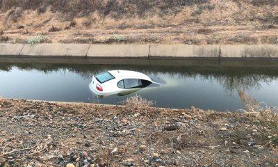 AionSur coche-agua-400x240 Recuperan semihundido en Lora del Río un coche robado en Huelva Sucesos