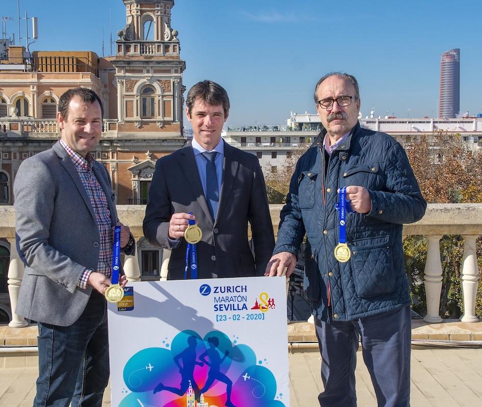 AionSur maraton-cartel Triana, la Torre del Oro o la Maestranza, en el cartel y medalla del Maratón de Sevilla Deportes Sevilla